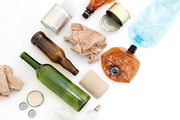 Recyclable waste, resources. Clean glass, paper, plastic and metal on white background. Copyspace for text. Recycling, reuse, garbage disposal, resources, environment and ecology concept