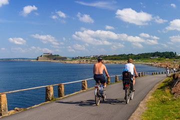 Family cycling along the sea