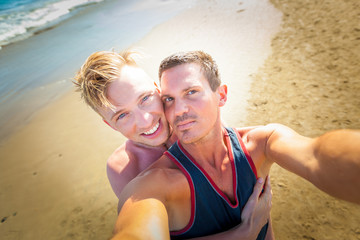 gay couple in love at the beach