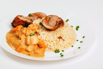 Grilled chicken with rice and sauce in a plate