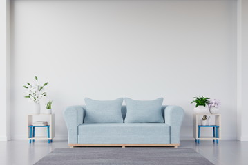 The interior has a blue sofa and flower on empty white wall background,3D rendering