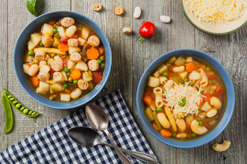 Minestrone soup with pasta and cheese or crostini.