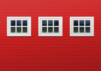 red barn facade with three windows