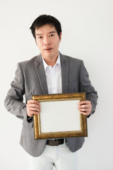 businessman with blank picture frame