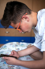 teenager uses a mobile phone