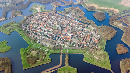 Aerial top view of Naarden city fortified walls in star shape and historic village in Holland, Netherlands