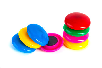 Colorful magnets - holders on a white background