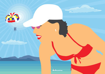 The girl in the hat by the sea. The girl in the red bathing suit on a background of the sea landscape.