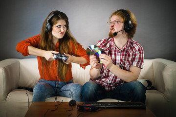 Pc gamer man and woman with game pad