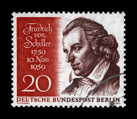 Johann Christoph Friedrich von Schiller (1759-1805), famous german poet, philosopher, physician, historian, circa 1959. vintage canceled postal stamp printed in Germany isolated on black background.