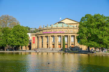 Zelfklevend Fotobehang Theater Stuttgart State Theatre Opera building and fountain in Eckensee lake, Germany