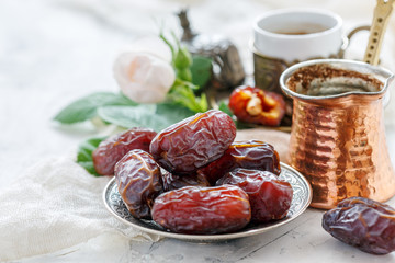 Organic dried dates on a bronze plate.
