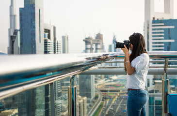 Photographer taking picture of Dubai cityscape