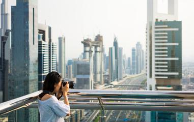 Photographer taking picture of Dubai cityscape