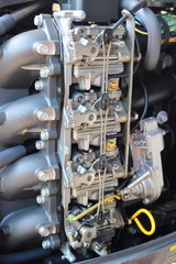 Four carburetors outboard motor