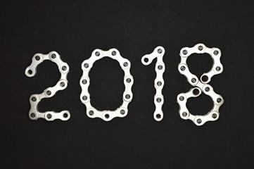 bike chain year 2018 on dark background