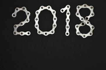 bike chain year 2018 upper section on dark background