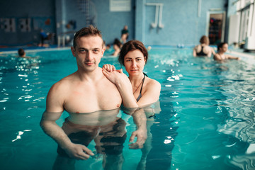 Male and female swimmers, leisure in swimming pool
