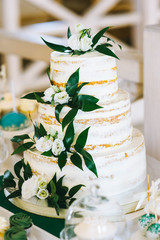 Brown wedding cake decorated with cream and fruits