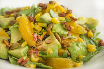 Healthy salad with mardarins and avocado