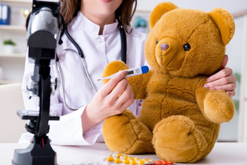 Child checking soft toy health