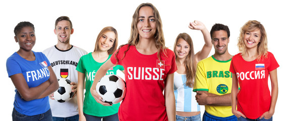 Swiss soccer fan with ball and cheering group of other fans