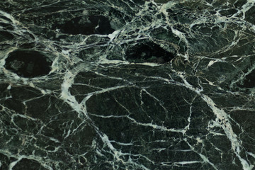 The dark green marble. Texture