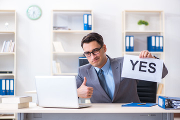 Businessman in positive yes answer in the office