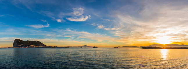 Amazing panoramic view on the rock of Gibraltar during sunset and the ships around it.