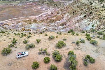 SUV car on desert - aerial view