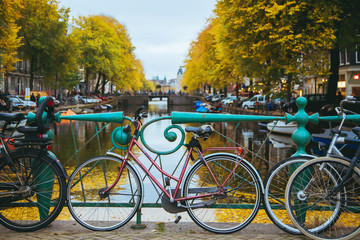 Bicycles standing on the bridge with an amazing Amsterdam view.