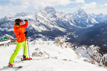 Male skier enjoying in the mountains covered with snow