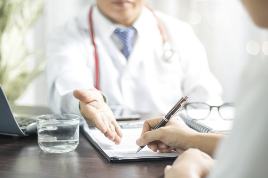 Doctor introduces patient signing on medical records before treat illness in hospital
