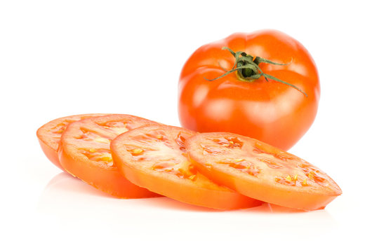 Sliced red tomato isolated on white background one whole with three circle slices.