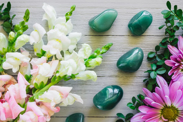 Gladiolus and Green Aventurine on White Table