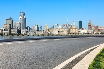 empty asphalt road and historic building scene in shanghai