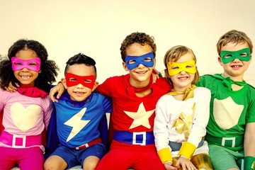 Superhero kids playing and having fun together