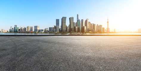 empty asphalt square road and city skyline in shanghai at sunset