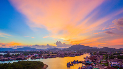 aerial scenery sunset at Siray  fishing port. Phuket Fishing Port is the largest fishing port. Located in Sire Island, next to Phuket Island. There is a large canal leading to the sea.
