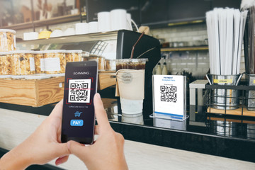 Qr code payment, E wallet , cashless technology concept. Man scaning  tag in Coffee accepted generate digital pay without money.