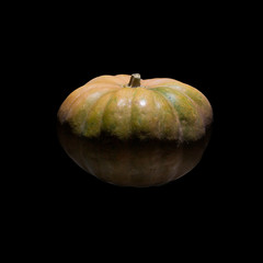 a pumpkin isolated on the black background