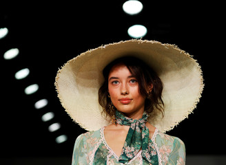 A model presents a creation by We Are Kindred during the Australian Fashion Week at Carriageworks in Sydney