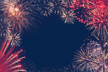 Stars of the fireworks are on a dark blue background