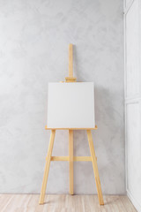 Wooden easel in the room