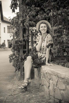 Lady in vintage dress, 1950s style on a vacation in Europe, retro style in modern life, pretty girl look nice and rest on trip with good mood