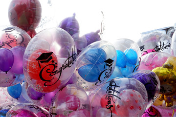 Various size, color ane type of balloons for congratulations graduation on isolated white background.