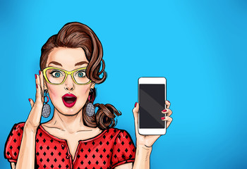 Attractive sexy girl in specs with phone in the hand in comic style. Pop art woman holding smartphone. Digital advertisement female model showing the message or new app on cellphone.  Wall mural