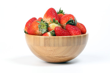 Strawberry in wooden bowl on white background