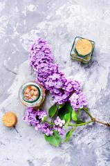 Fototapete - Bottle of lilac essential oil