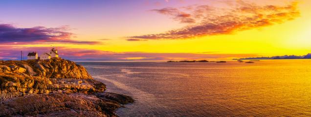 Wall Mural - Sunset over the lighthouse in Henningsvaer on Lofoten islands